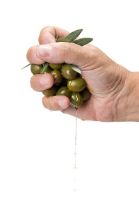Blog34-Hand-Squeezing-Olives-with-Oil.jpg