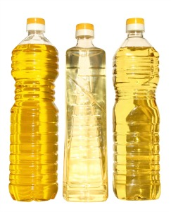 Bottles of Olive, Canola and Vegetable Oil Compared