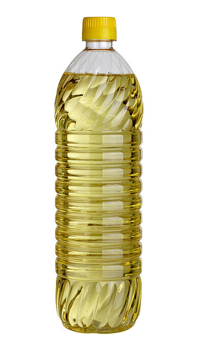 close up of cooking oil bottle on white background with clipping path